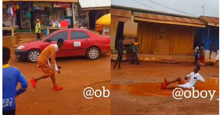 [Video] Sarkodie fan switches to crazy mode as he sleeps in the mud dancing to hastalavista