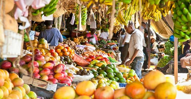 Fruit and vegetables at a market in Kenya. The WHO is pushing for consumption of fresh fruits and vegetables, whole grains, beans, fish and unsaturated fats. - Source: Shutterstock