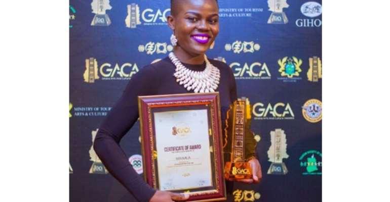 Wiyaala displaying her award
