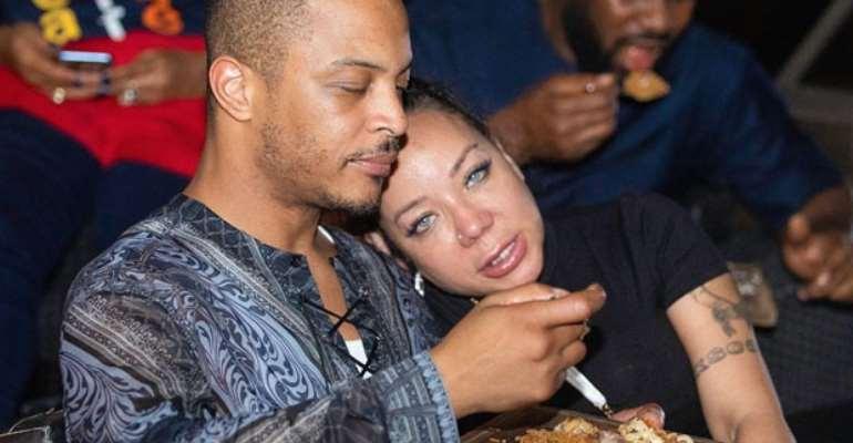 T.I. enjoying Ghanaian jollof with his wife
