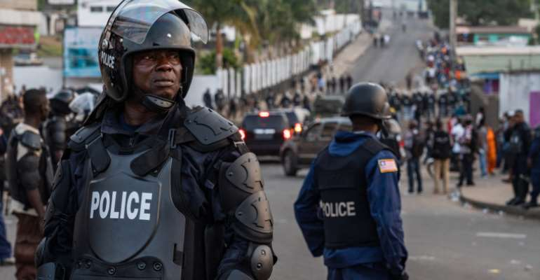 Police are seen in Monrovia, Liberia, on January 6, 2020. Liberian journalist Gloria Tamba has been in hiding since October. (AFP/Carielle Doe)