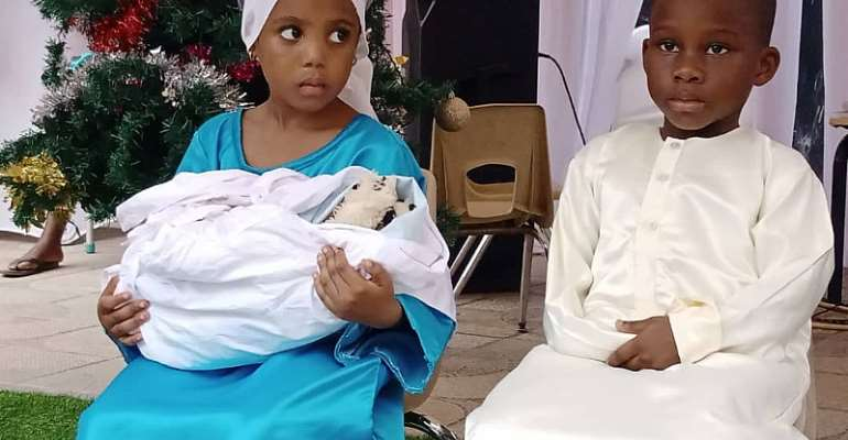 Remalj kids act as Mary and Joseph.