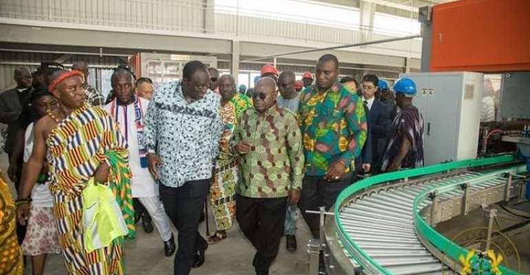 President Akufo-Addo, right inspecting the newly commissioned factory.