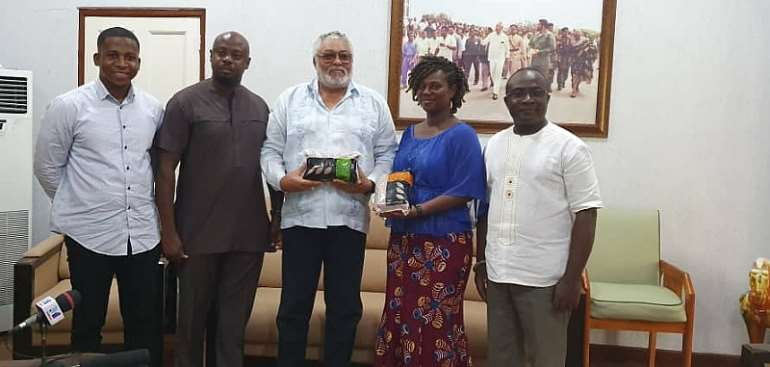 Former President Jerry John Rawlings (middle)
