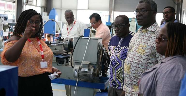 Dr. Lucy Agyepong, Associate Dean, Faculty of Engineering (R-1) taking Prof. Frimpong-Boateng (L-2) through some equipment at the STEM lab