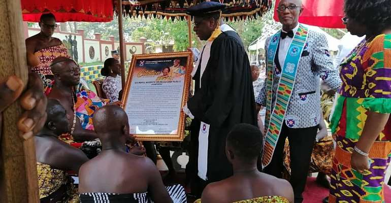 Otumfuo Osei Tutu II receiving a citation from Rt Rev Prof Mante