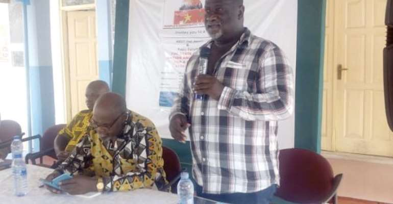 Dr Kojo Opoku Aidoo (standing) delivering a speech at the forum