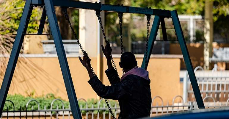 Migrant sitting alone in a playground. - Source: Shutterstock