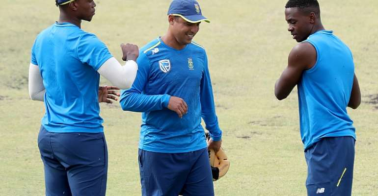 From left, Lungi Ngidi, fielding coach Justin Ontong and Kagiso Rabada of the South African cricket team during a training session ahead of a 2018 test match in Australia - Source: AAP/Richard Wainwright