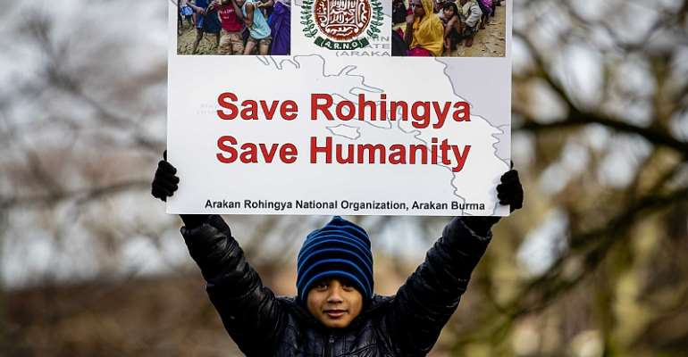A protester supports the Rohingya outside the Peace Palace in The Hague, Netherlands, on 10 December 2019.  - Source: EPA-EFE/Sem van der Wal