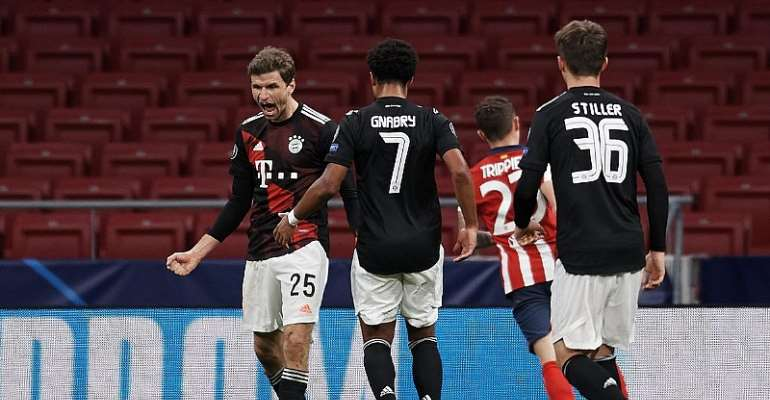 Thomas Muller of Bayern celebrates after scoring his sides first goal during the UEFA Champions League Group A stage match between Atletico Madrid and FC Bayern Muenchen at Estadio Wanda Metropolitano on December 1, 2020 in Madrid, Spain.  Image credit: Getty Images