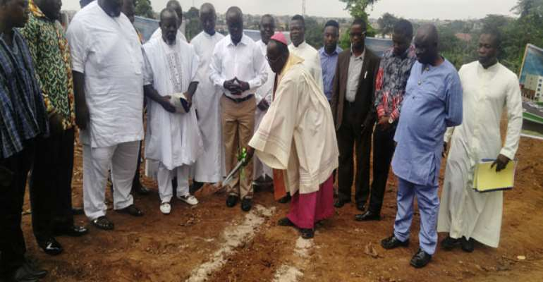 Most Rev Anokye With KMA Boss Cutting The Sod Copy
