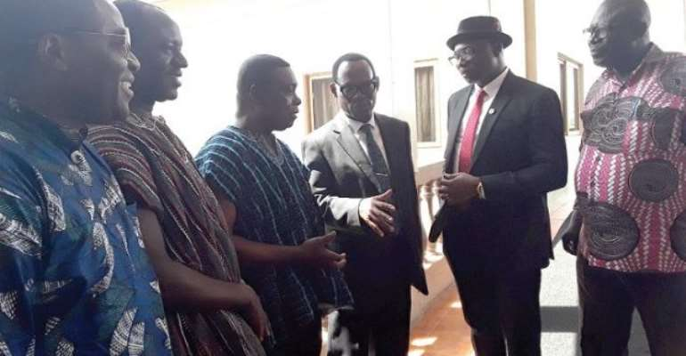 Mr Benjamin K. Gyasi (3rd right) having a chat with Mr Christian Addai-Poku (2nd right) while some of the principals of colleges of education look on
