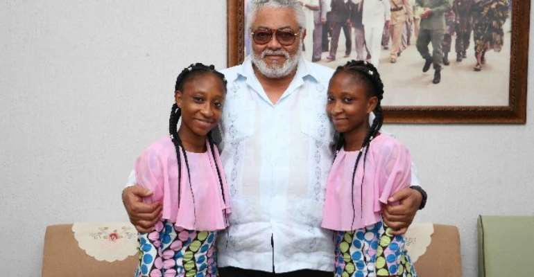 Lydia and Linda Awui with Former President Jerry John Rawlings