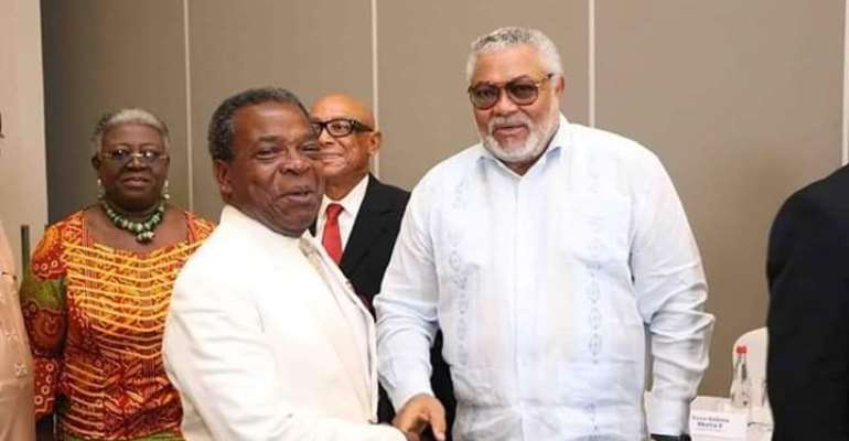 Mr. Rawlings left in a handshake with Mr. Emile Short, the Chairman for the EC's Advisory Committee