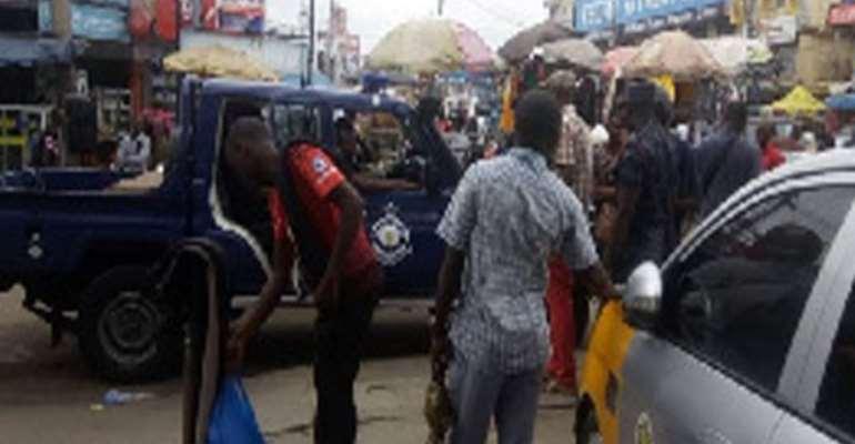 Policemen patroling TipToe Lane at Circle, Accra after the clash yesterday