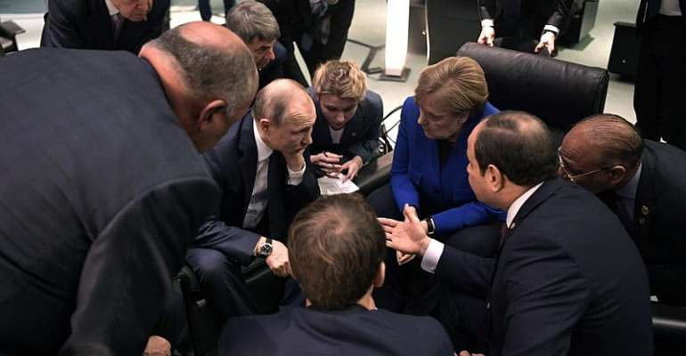 German Chancellor Angela Merkel speaks with Russian President Vladimir Putin during the International Libya Conference in Berlin, Germany, 19 January 2020 - Source: EPA/ALEXEI NIKOLSKY/SPUTNIK/KREMLIN