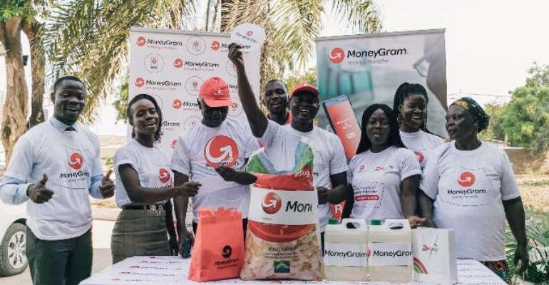 MoneyGram & Zeepay team in group picture with Benjamin Ashitey.