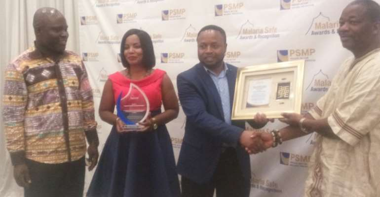 The staff of AngloGold Ashanti (left) receiving their award