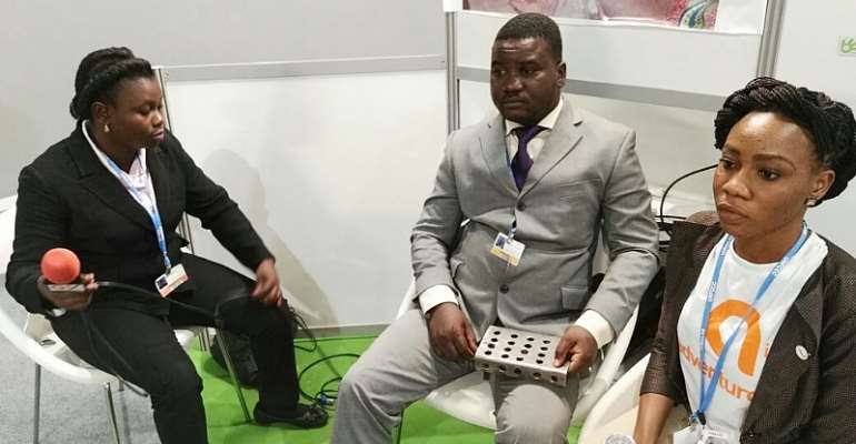 Kenneth Nana Amoateng, Middle, With One Of The Products During Last Year's COP22 Climate Change Conference In Morocco
