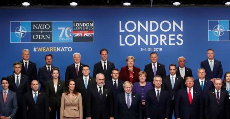 NATO leaders pose for a photo during the summit at the Grove Hotel in Watford, northeast of London on December 4, 2019 [Christian Hartmann/Pool/AFP]