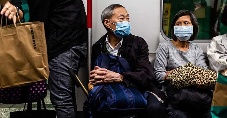 Passengers on a tram in China wear surgical masks to guard against viral infection. - Source: Willie Siau/SOPA Images/LightRocket via Getty Images