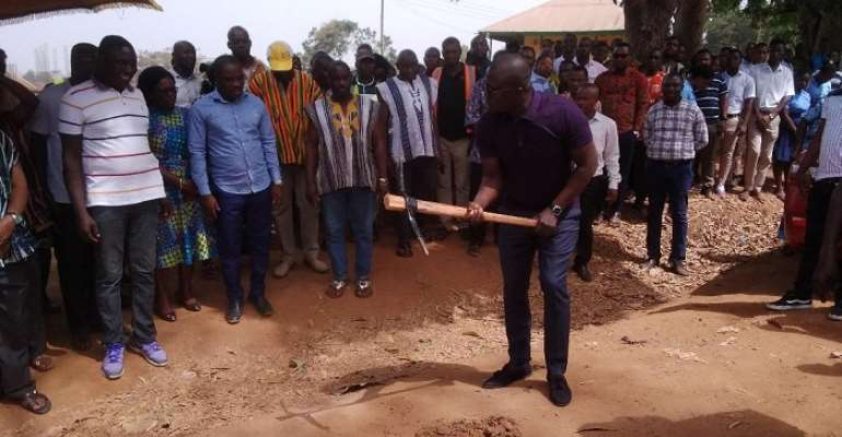 Bryan Acheampong digging the grounds as Nana Aseidu Agyemang, the DCE and others look on