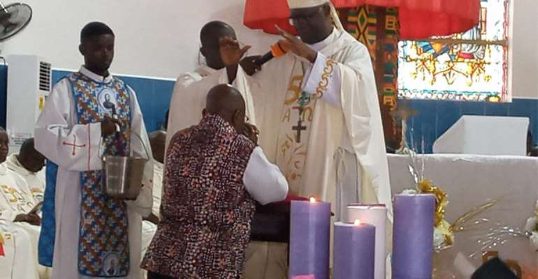 The President being prayed for by Most Rev. Bonaventure Kwofie