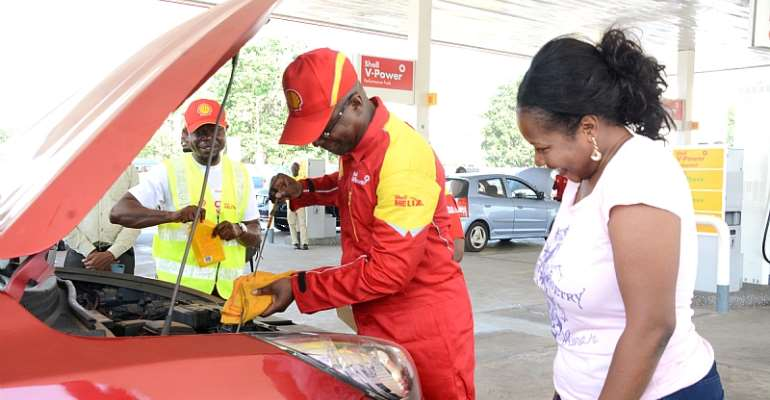The Managing Director of Vivo Energy Ghana, Mr. Ben Hassan Ouattara conducting under bonnet checks on a customer's vehicle