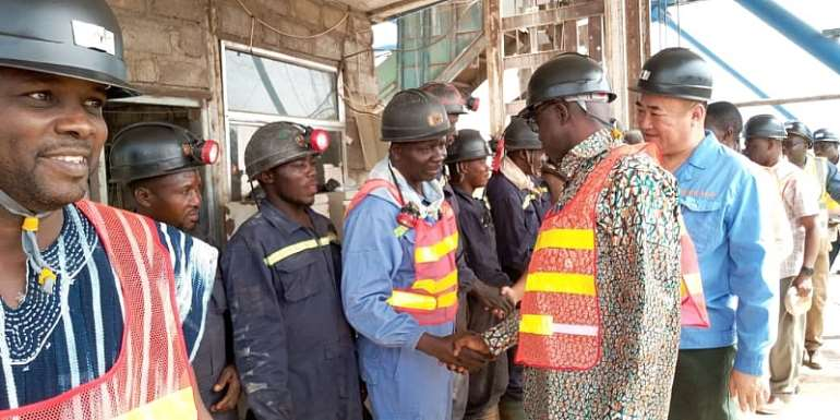 Minister for Lands and Natural Resources interacting with miners at Gbane