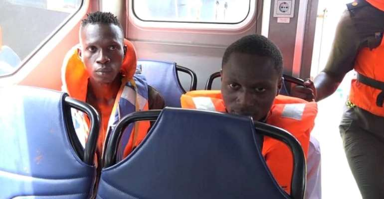 The two suspected stowaways after their arrest