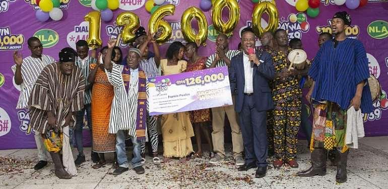Francis Pwalua and his family members in a celebratory mood with NLA boss Kofi Osei Ameyaw