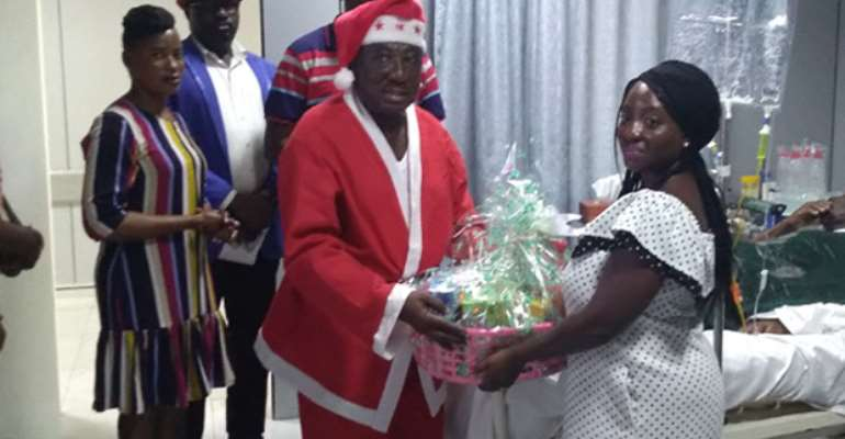 Captain Duah rtd presents a gift to a relative of a veteran
