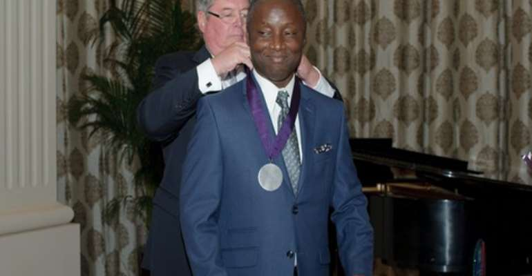 The University Of  Central Arkansas's Alumnus Dr. Kofi Boahene Receiving An Award From The School For His Distinguished Medical Career