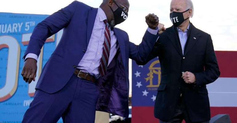 Joe Biden (right) strongly supported Democratic Senate candidate Raphael Warnock in the campaign.