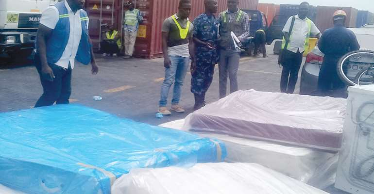 Shipping agents captured negotiating a deal with a customs official.