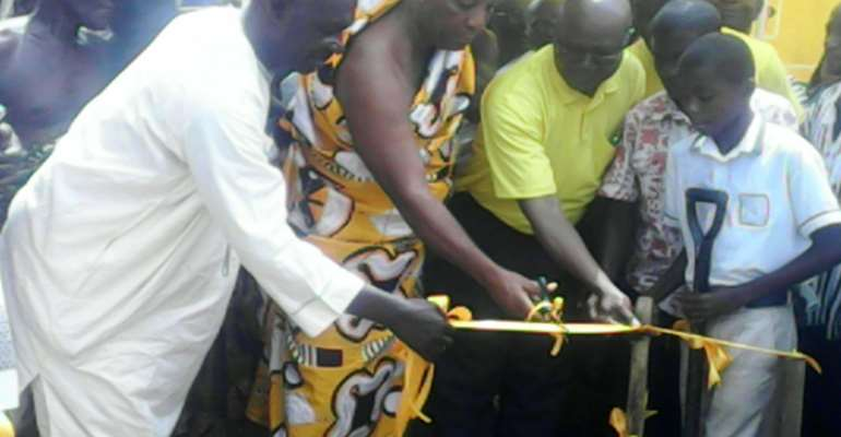 Nana Antwi Adjei Cutting The Tape Assisting By Manager And The MP