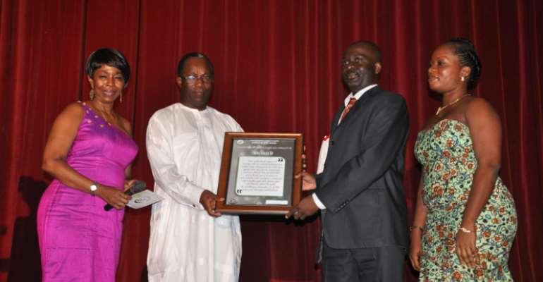 Dr. Cornelius Gligui receiving the award from Prof. Nii Otu Nartey, former C.E.O Korle-Bu Teaching Hospital.