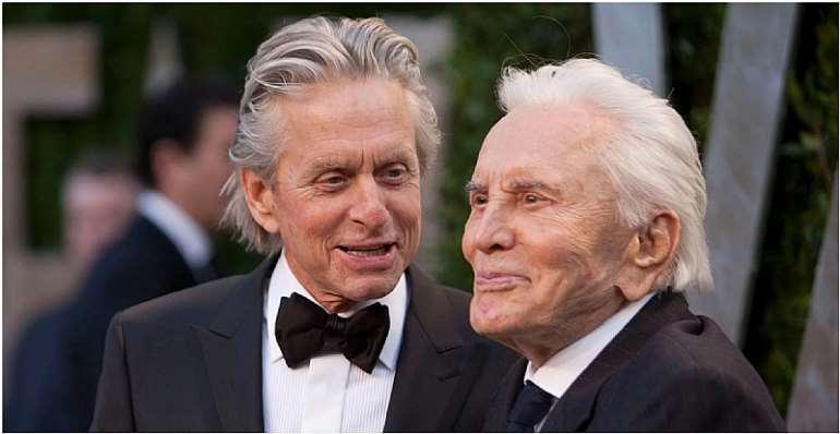 Michael and Kirk Douglas in 2012. (ADRIAN SANCHEZ-GONZALEZ/AFP via Getty Images)