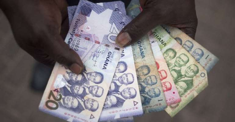 Ghanaians Hoarding Dollars Put Cedi on Course for 19-Month Low