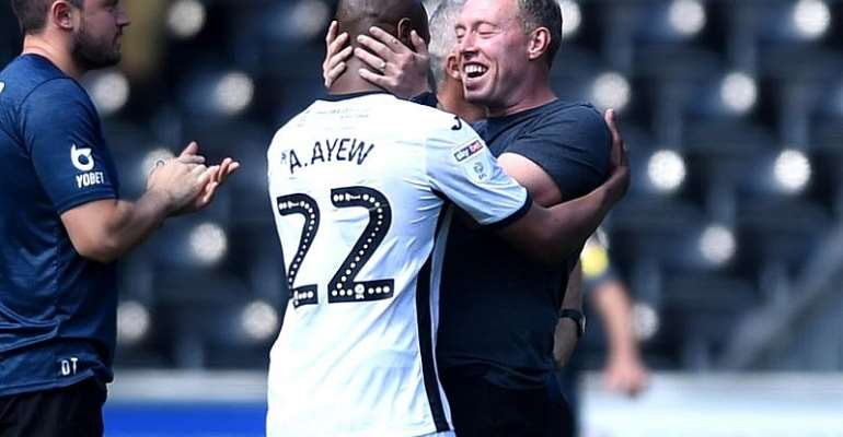 Andre Ayew with Swansea boss, Steve Cooper