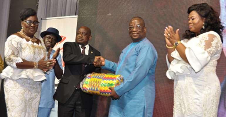 Mr Patrick Akorli (left) receiving a parting gift from Barima Osei Kwadwo