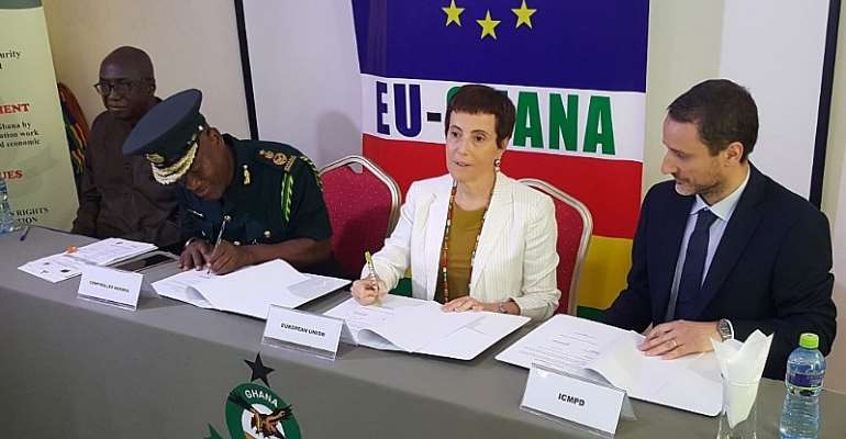 The Controller General Of Immigration, Kwame Asuah Takyi,(2nd from left) Ambassador Diana Acconcia and Marco Bordignon, Project Manager of ICMPD signing the MoU between ICMPD and GIS