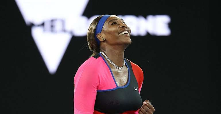 Serena Williams of the US celebrates after winning against Romania's Simona Halep during their women's singles quarter-final match on day nine of the Australian Open tennis tournament in Melbourne  Image credit: Getty Images