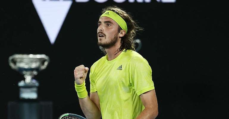 Greece's Stefanos Tsitsipas celebrates after winning against Spain's Rafael Nadal during their men's singles quarter-final match on day ten of the Australian Open tennis tournament in Melbourne