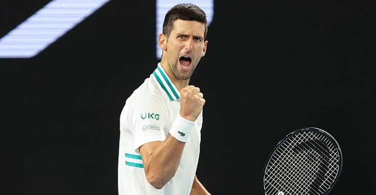 Serbia's Novak Djokovic reacts after a point against Russia's Aslan Karatsev during their men's singles semi-final match on day eleven of the Australian Open tennis tournament in Melbourne  Image credit: Getty Images