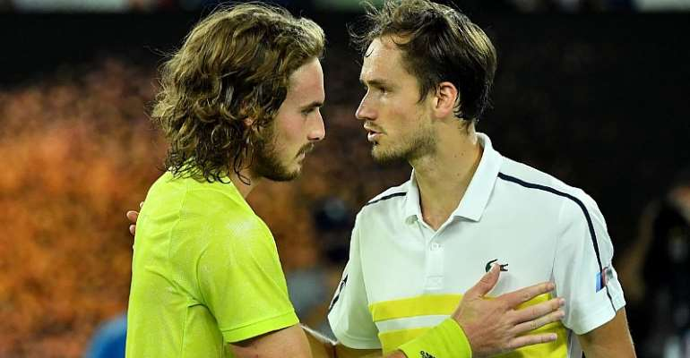 Russia's Daniil Medvedev (R) and Greece's Stefanos Tsitsipas greet each other after their men's singles semi-final match