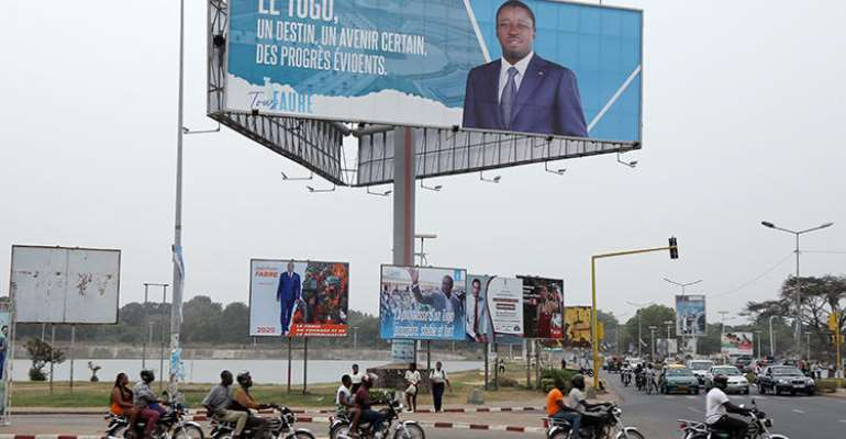 A billboard of President Faure Gnassingbe is seen in Lome, Togo, on February 19, 2020. CPJ recently joined a letter calling for the Togolese government to maintain internet access throughout the upcoming election. (Reuters/Luc Gnago)