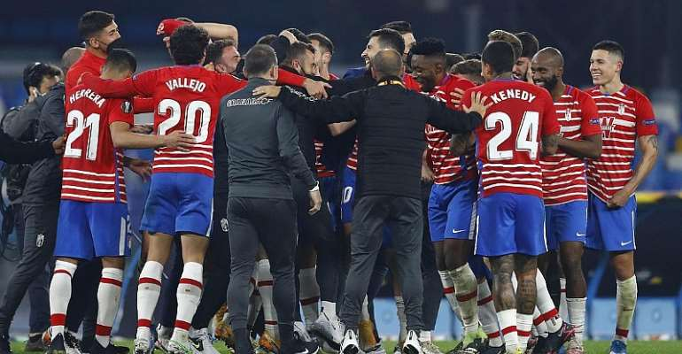 Players of Granada CF celebrate after winning the UEFA Europa League Round of 32 match between SSC Napoli and Granada CF on February 25, 2021 in Naples, Italy.