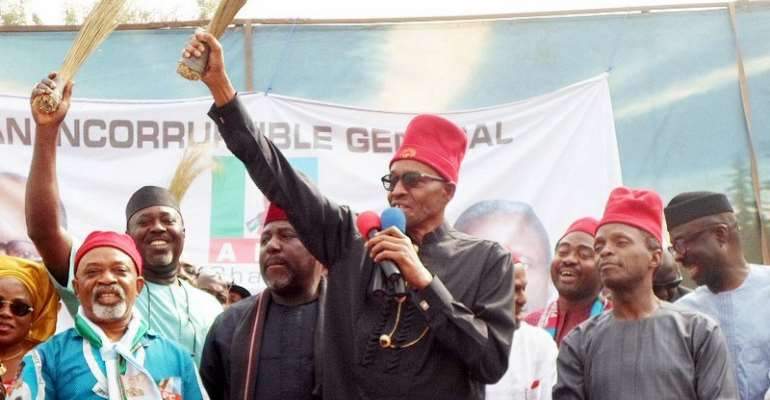 President Buhari campaigning  Premium Times